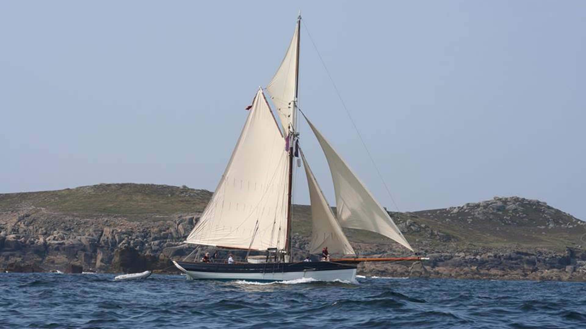 Amelie Rose sails along the coast of St Marys whilst on an Isles of Scilly Adventure