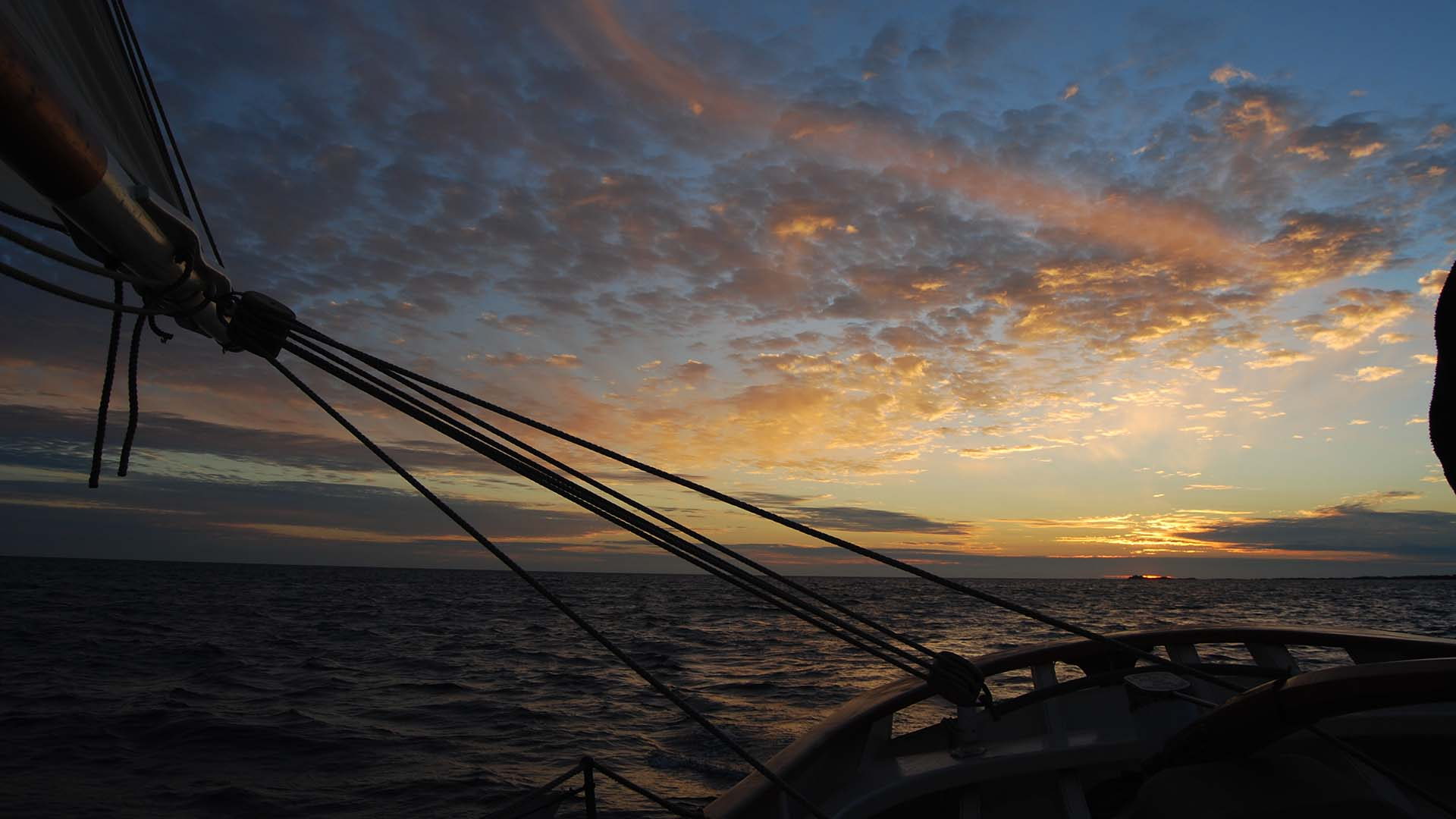 View aft aboard the Amelie Rose at sea at dusk
